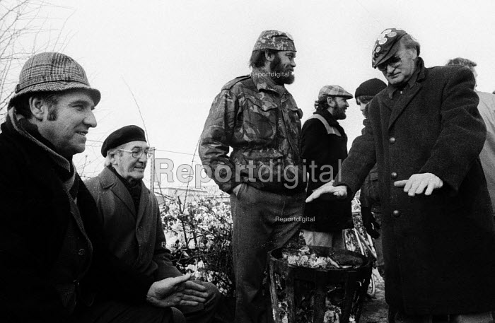 Pickets keep warm around a brazier in the snow. ASLEF picket line at Shirebrook in North Derbyshire, where railway workers refused to move coal throughout the miners strike in solidarity with the NUM. - John Harris - 1985-01-17