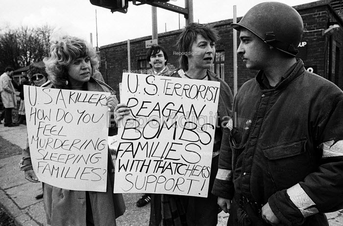 Bombing of Libya. Upper Heyford Air Base Women directly confront a US soldier based at Upper Heyford against the use of US air bases on British soil used by American F111s to bomb Libya. 20th Tactical Fighter Wing, RAF Upper Heyford Air Base - John Harris - 1986-04-15