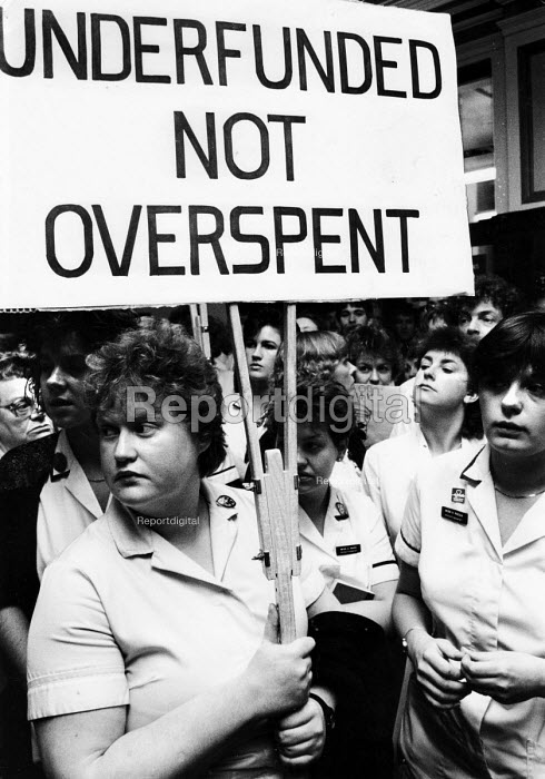 Hospital workers from Manchester Royal Infirmary occupy a District Health Authority meeting to protest against cuts and job losses in their local NHS provision, Manchester, 1988. - John Harris - 1988-01-19