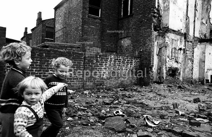 Children playing at the rear of a block of terraced housing in the process of being pulled down in Liverpool in the mid-1970s. - John Sturrock - 1974-11-06