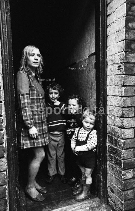 Mother with her children in the doorway of their terraced house in Liverpool in the mid-1970s - John Sturrock - 1974-11-06