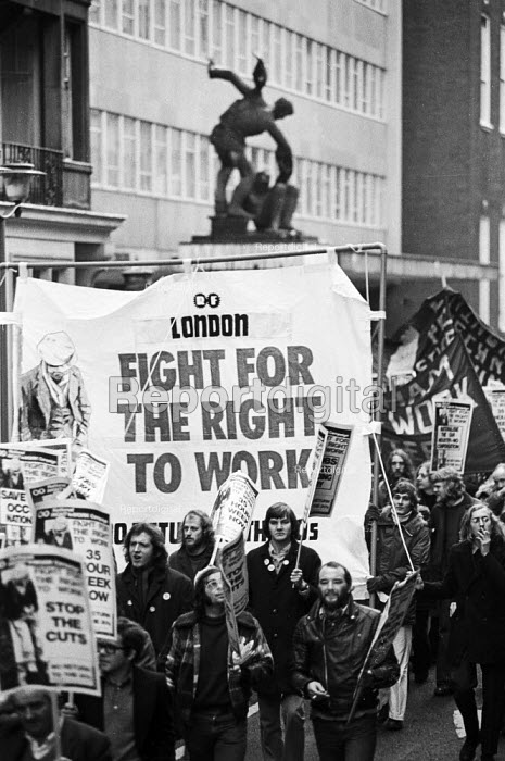 Right To Work march passes by TUC headquarters, which had been occupied by campaigners just the day before, London, 1975. - John Sturrock - 1975-11-27
