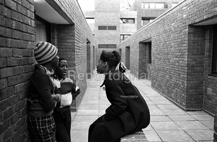 Children resident on the Hindrey Estate in east London chat together on the walkways of the council estate - John Sturrock - 1976-04-27
