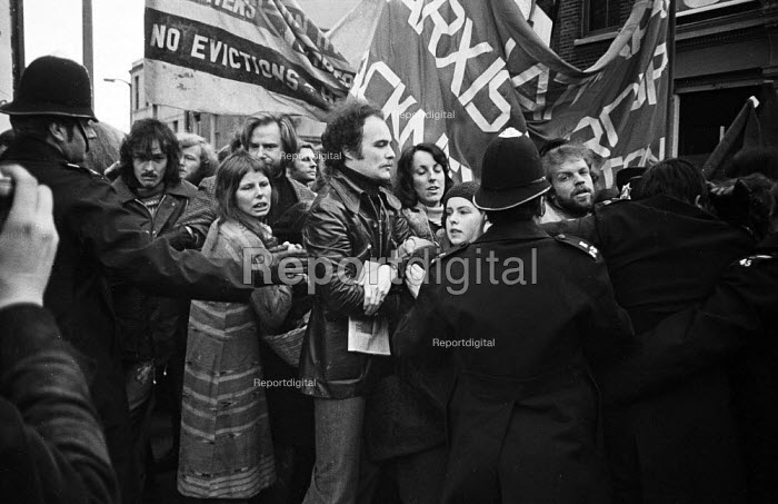 Police grapple with protestors outside the offices of the Islington estate agents, Prebble, during a demonstration against the active role of the company in the eviction of Islington tenants from their homes to further the gentrification of the borough and it's housing stock. London - Mike Sheridan - 1974-12-07