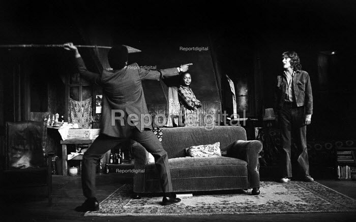 The Banana Box, Hampstead Theatre, London, 1973. The play was later turned into Rising Damp, a highly successful ITV comedy starring many of the original cast from this theatre production. Don Warrington, with spear, Elizabeth Adare and blues singer, Paul Jones. - Peter Harrap - 1973-05-17