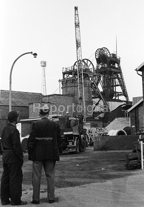 Workers at Markham Main Colliery in Derbyshire look towards the pitshaft, site of a lift shaft accident at the pit on 30th July, 1973 which resulted in the deaths of 18 of their workmates. - Peter Harrap - 1973-08-10