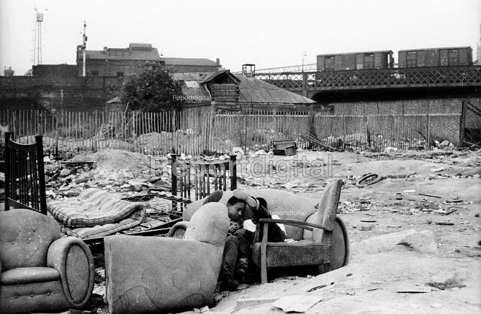 Two young boys playing outdoors, probably near King's Cross, on a post-war bomb-site, still a common feature of some poorer parts of London even into the early 1960's. .... - Romano Cagnoni - 1962-07-11