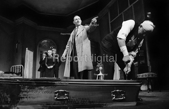 LOOT written by Joe Orton and staged at the Jeanette Cochrane Theatre in Holborn in London in 1966. Kenneth Cranham, left, Sheila Ballantine & Simon Ward in the background, with Michael Bates & Gerry Duggan in the foreground - Romano Cagnoni - 1966-09-27
