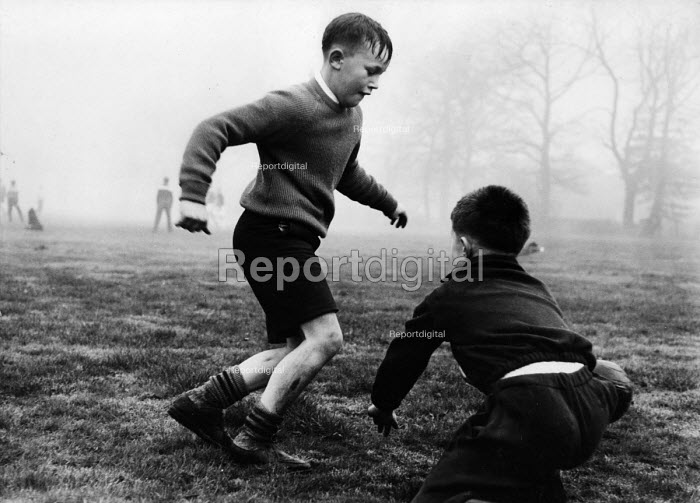 Polish refugee children playing football in west London in the late 1950s - Roger Mayne - 1958-02-15