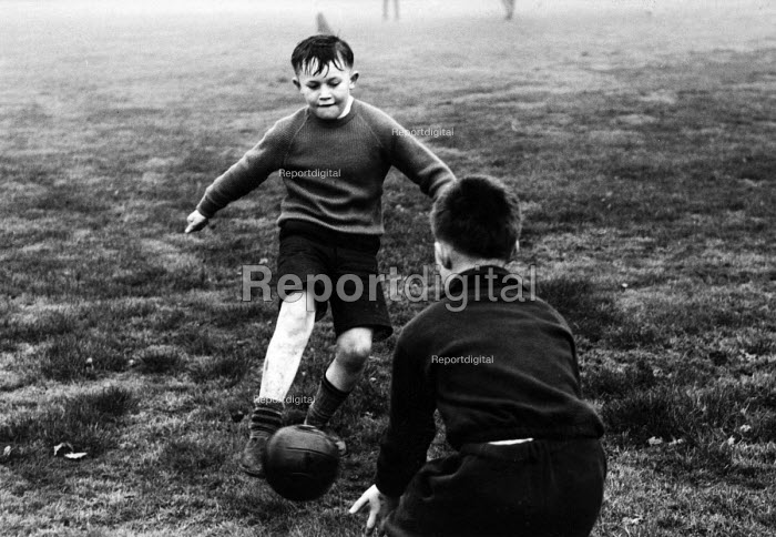 Polish refugee children playing football in a west London park in the late 1950s - Roger Mayne - 1958-02-15