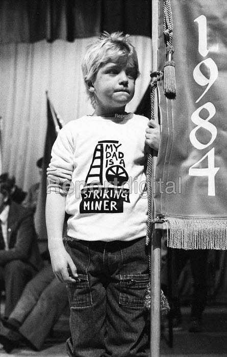 Scottish rally in support of the miners strike. Young boy wears a sweat shirt with the words My dad is a striking miner, designed by Lucy Morrison NALGO - Rick Matthews - 1984-10-27