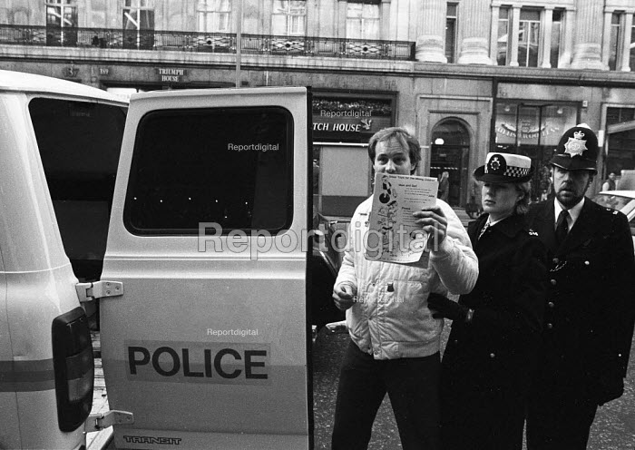 Miners supporter arrested for allegedly causing an obstruction outside Hamleys Toy Store in Regent Street, whilst helping to launch an appeal for donations of Christmas toys for striking miners children during the national miners strike. - Stefano Cagnoni - 1984-11-15