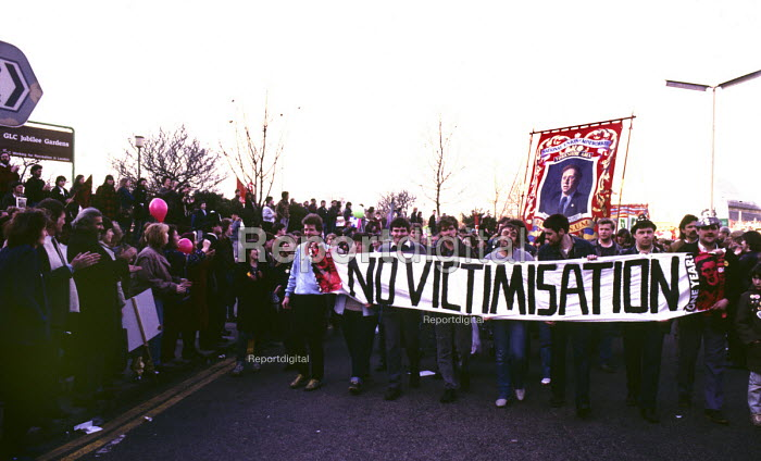 One year into the MIners Strike of 1984-85, mIners from the NUM carry the banner from Bentley Colliery in Yorkshire and a banner reading No Victimisation on a march through London against Government attacks on local democracy - Stefano Cagnoni - 1985-03-06