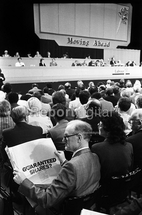 Labour Party delegate reading newspaper with British Petroleum (BP) shares advertisement as the nationalised oil idustry is privatised, Labour Party Conference, Blackpool, 1987 - Stefano Cagnoni - 1987-10-01