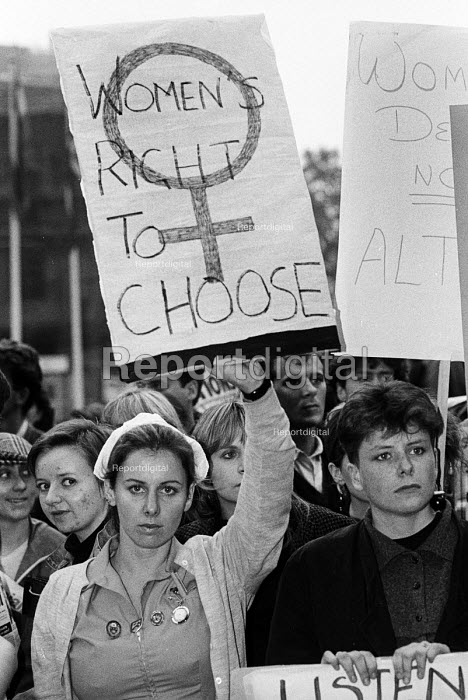 A nurse in uniform joins other women protesting against the Alton Bill on abortion, before a meeting organised by LIFE, the anti-abortion group, London, 1987. The Alton Bill, a Private Member's Bill, proposed reducing the time limit to women seeking an abortion. - Stefano Cagnoni - 1987-10-27