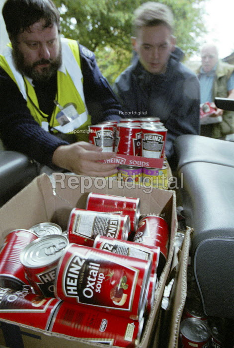 Roy Paul,who works for Mersey Mission to Seafarers, collecting food from a local hotel. The food will be given to sailors who are often stranded in Liverpool without money. - Rob Bremner - 2002-02-03