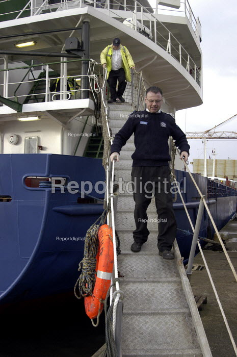Sean, who works for Mersey Mission to Seafarers, ship visiting at the Port of Liverpool. The mission was established 150 years ago to look after the welfare of merchant seafarers. - Rob Bremner - 2003-11-23