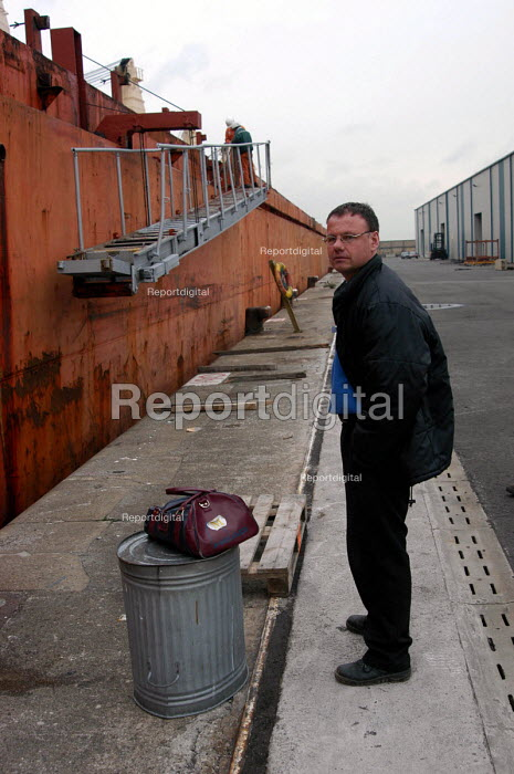 Sean Draper, chaplain's assistant at Mersey Mission to Seafarers, waiting to board a ship in Liverpool docks. - Rob Bremner - 2004-03-26