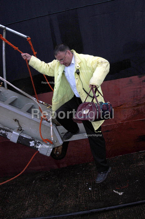 Sean Draper, chaplain's assistant at Mersey Mission to Seafarers, leaving a ship in Liverpool's port after visiting it's crew to check on their welfare. - Rob Bremner - 2004-03-23