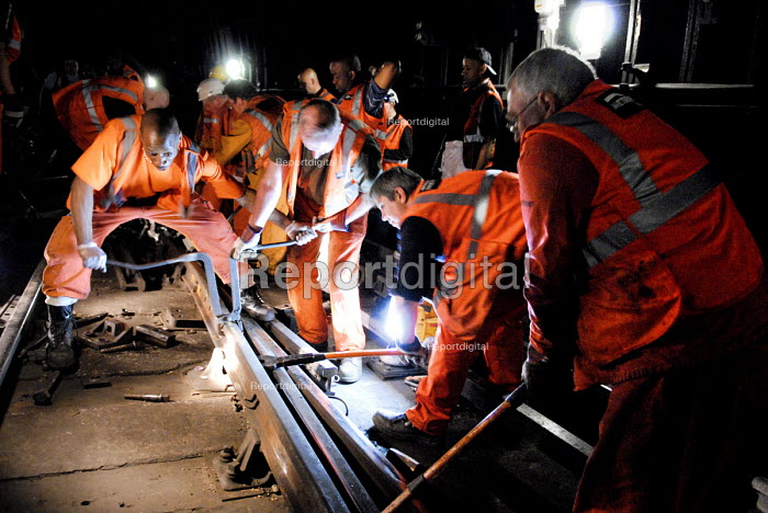 Workers helped by the Emergency Response Unit (ERU) repair the rails on the London Underground near Warren Street Underground Station, London. The ERU works in conjunction with the emergency services in responding to derailments and accidents on the London Underground and is based at Acton Town Underground Station, London. - Rogan Macdonald - 2006-06-05