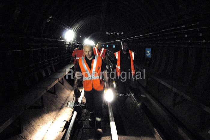 The Emergency Response Unit (ERU) return to the surface after repairing a rail at Warren Street Underground Station, London. The ERU works in conjunction with the emergency services in responding to derailments and accidents on the London Underground and is based at Acton Town Underground Station, London. - Rogan Macdonald - 2006-06-06