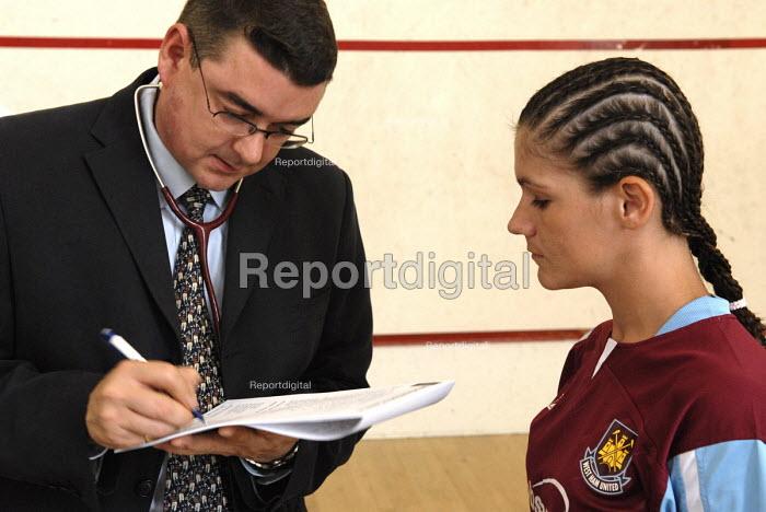 A doctor examines boxer Shanee Martin before a fight British Masters Female Super Flyweight Title, Goresbrook Leisure Centre in Dagenham, London - Rogan Macdonald - 2006-07-23