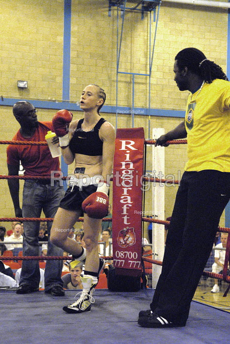Boxer Juliette Winters entering the ring for the fight for the British Masters Female Super Flyweight Title, Goresbrook Leisure Centre, Dagenham, London. - Rogan Macdonald - 2006-07-23