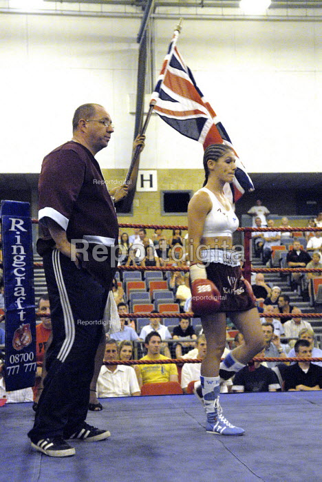 Boxer, Shanee Martin, enters the ring for the fight for the British Masters Female Super Flyweight Title, At Goresbrook Leisure Centre in Dagenham, London. - Rogan Macdonald - 2006-07-23