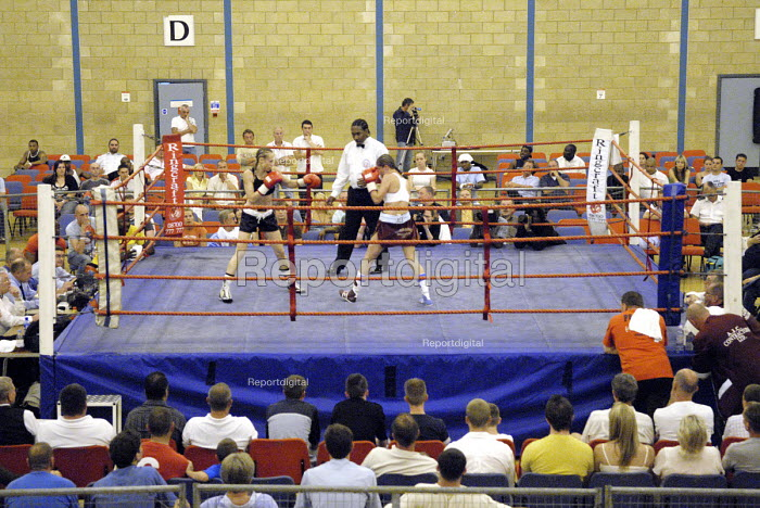 Woman boxer Shanee Martin (white top), fighting Juliette Winters, (black top) for the British Masters Female Super Flyweight Title. At Goresbrook Leisure Centre in Dagenham, London. - Rogan Macdonald - 2006-07-23