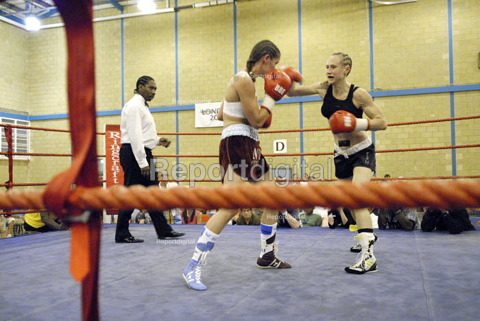 Woman boxer Shanee Martin (white top) fighting Juliette Winters (black top) for the British Masters Female Super Flyweight Title, At Goresbrook Leisure Centre in Dagenham, London. - Rogan Macdonald - 2006-07-23