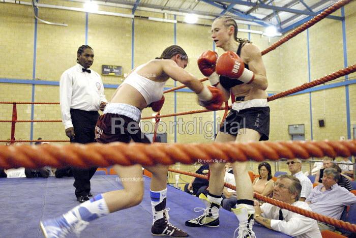 Woman boxer Shanee Martin (white top) fighting Juliette Winters (black top) for the British Masters Female Super Flyweight Title, At Goresbrook Leisure Centre in Dagenham, London. - Rogan Macdonald - 2006-07-23