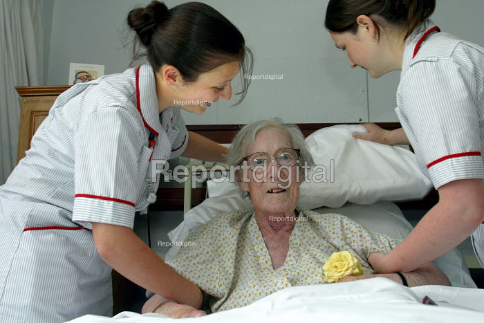 Health workers, student nurses with an elderly patient - Roy Peters, RP511q270.jpg