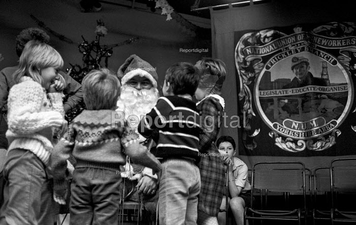 Santa Claus giving out presents at a Christmas party for... - Ray Rising, RR1308224.jpg