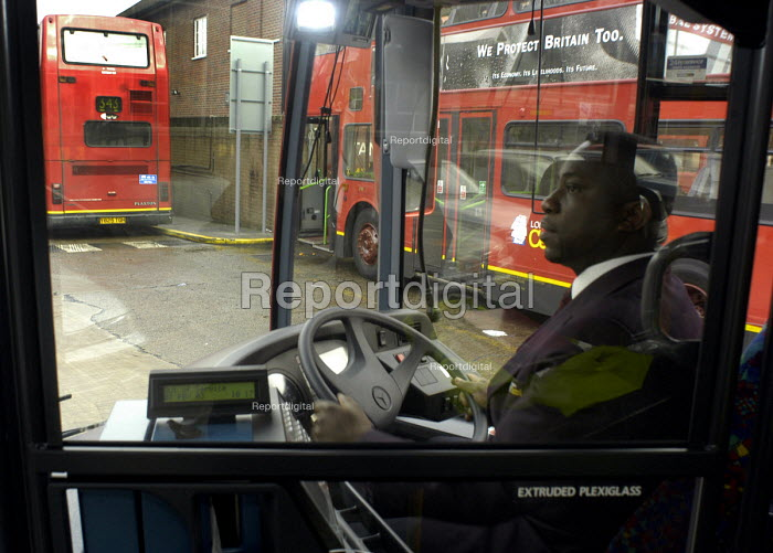 Bus driver driving his vehicle from the bus depot on the... - Stefano Cagnoni, SC034363.jpg