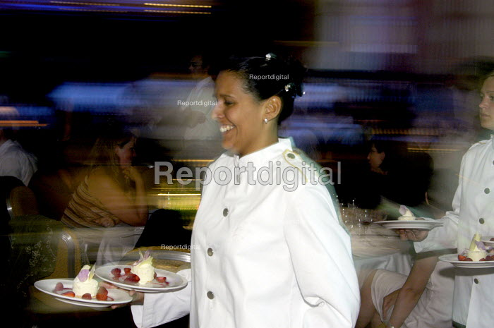 Waitress serving dessert towards the end of the evening at a function in a top class London hotel - Stefano Cagnoni - 2003-07-10