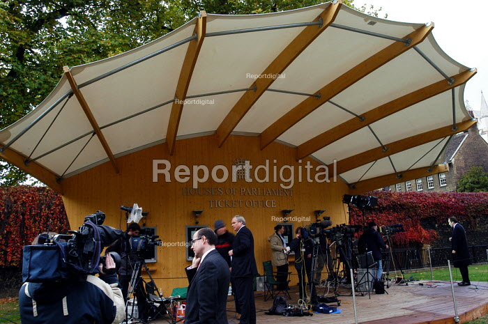 Journalists sheltering under a canopy as they file their... - Stefano Cagnoni, SC03NROB.jpg