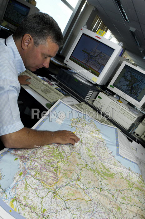 Staff member checking hard copy of map during computerized... - Stefano Cagnoni, SC040034.jpg