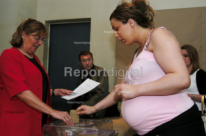 Heavily pregnant French voter casts her ballot in the town hall polling station of Le Blanc Mesnil, a northern suburb of Paris, in the national referendum on the European Constitution. The final outcome by a clear majority was Non. - Stefano Cagnoni - 2005-05-29