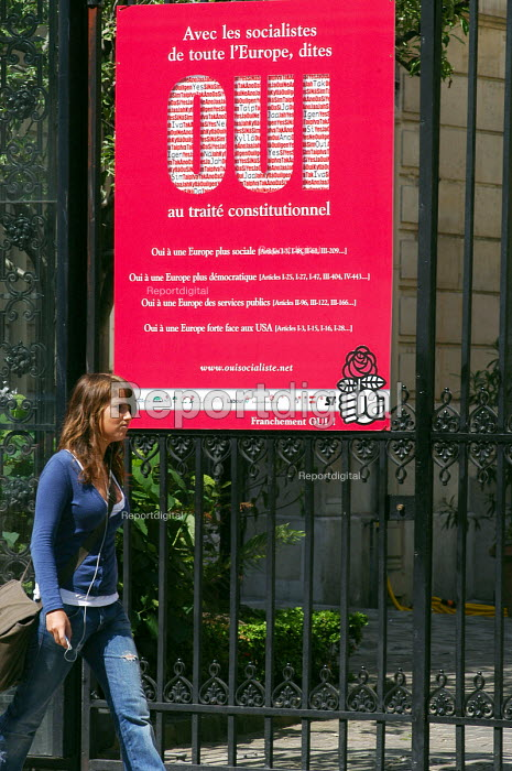 Woman walking in street outside the Socialist Party Headquarters in Paris adorned with a Oui poster on it gates, urging a Yes vote in the national referendum on the European Constitution. The final outcome by a clear majority was Non. - Stefano Cagnoni - 2005-05-28