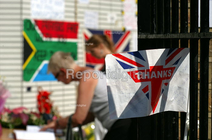 Visitors sign a book of condolences at a makeshift shrine outside King's Cross Station, one of the sites of the terrorist attacks which caused death and injury to many Londoners - Stefano Cagnoni - 2005-07-12