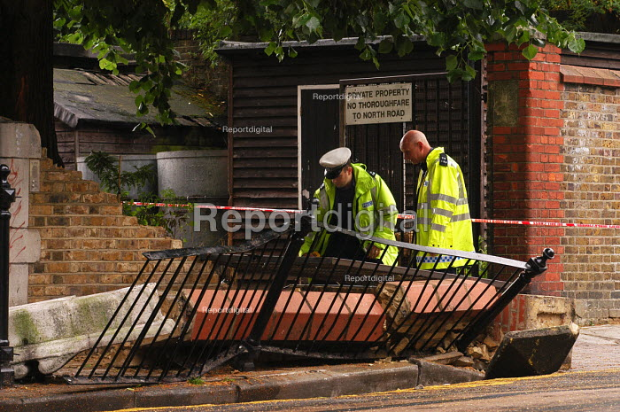 Police officers investigate the scene of an accident which caused a wall to collapse outside a primary school, resulting in serious injury to a passing pupil - Stefano Cagnoni - 2005-06-30