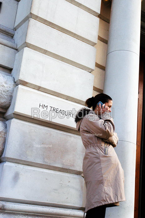 Pregnant woman talks on her mobile telephone outside the Treasury offices in Whitehall - Stefano Cagnoni - 2005-01-13