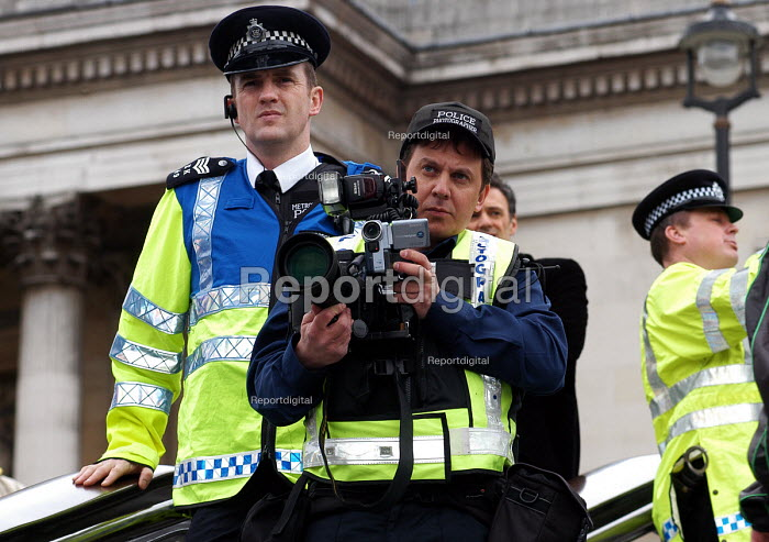 Police photographer at work recording participants at a Freedom of Expression rally held at Trafalgar Square, The rally was called to highlight attacks on freedom of speech and censorship of political and religious opinion - Stefano Cagnoni - 2006-03-25