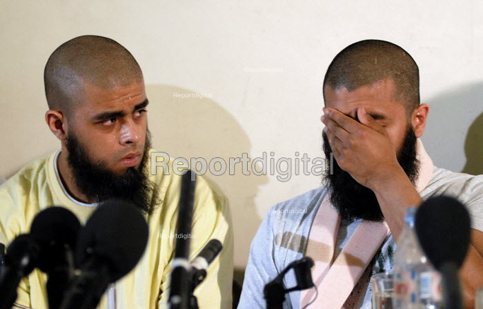 Brothers Abul Koyair and Mohammed Abdul Kahar, who was shot by police, tell the story of their ordeal when police raided their Forest Gate home during an anti-terrorist operation, at a press conference in East London. - Stefano Cagnoni - 2006-06-13