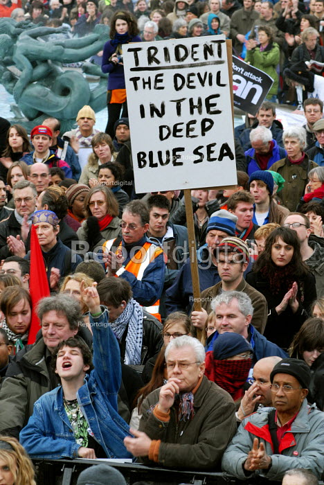 TRIDENT THE DEVIL IN THE DEEP BLUE SEA reads a banner at the No Trident rally in Trafalgar Square, calling on a halt to the nuclear arns race and a pull out of troops from Iraq - Stefano Cagnoni - 2007-02-24
