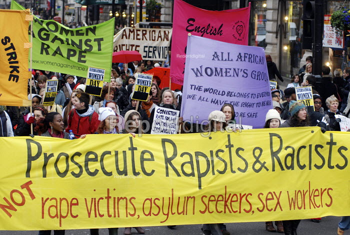 Prosecute Rapists & Racists reads a banner carried by women marching through London on International Women's Day calling for an end to male violence against women - Stefano Cagnoni - 2008-03-06