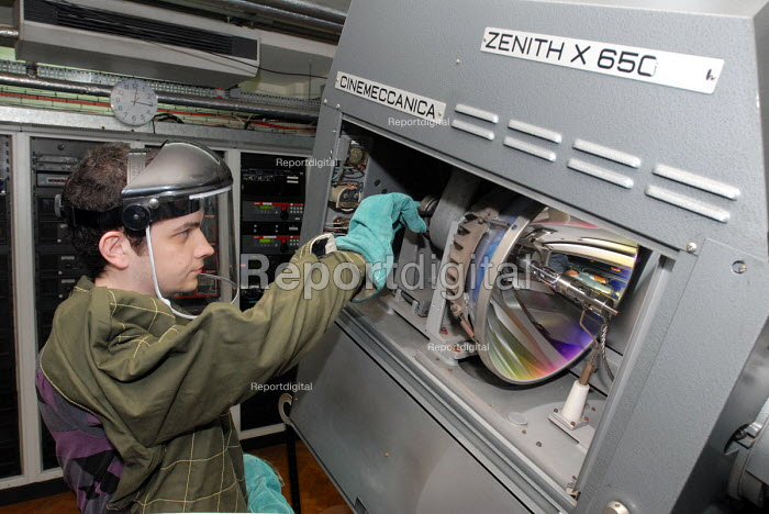 Film Projectionist at the Odeon Cinema in London's Leicester Square taking great care to prepare the equipment and wearing protective clothing whilst doing so - Stefano Cagnoni - 2008-06-23