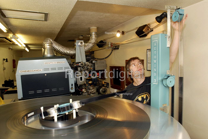 Film Projectionist at a cinema in London's Leicester Square preparing the projector in readiness to show a movie - Stefano Cagnoni - 2008-06-23