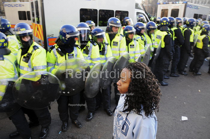Lone female student faces a phalanx of riot police as she arrives in Parliament Square at the end of a march through London to Parliament to protest against the vote to increase fees for University education - Stefano Cagnoni - 2010-12-09