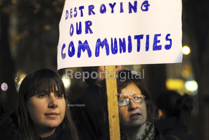"""""""Destroying Our Communities"""" reads a banner at a rally at Islington Town Hall against Government cuts in local council budgets which will severely affect services provided for local communities. - Stefano Cagnoni - 2010-12-14"""